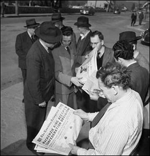 Citizens reading newspaper headlines concerning confederation with Canada,